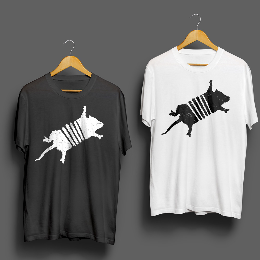 A set of two t-shirts, one black and one white, bearing the logo for the Road Kill Grill and Jamboree.