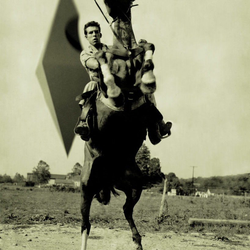 A man on a rearing horse, with the anomaly in the sky behind him.