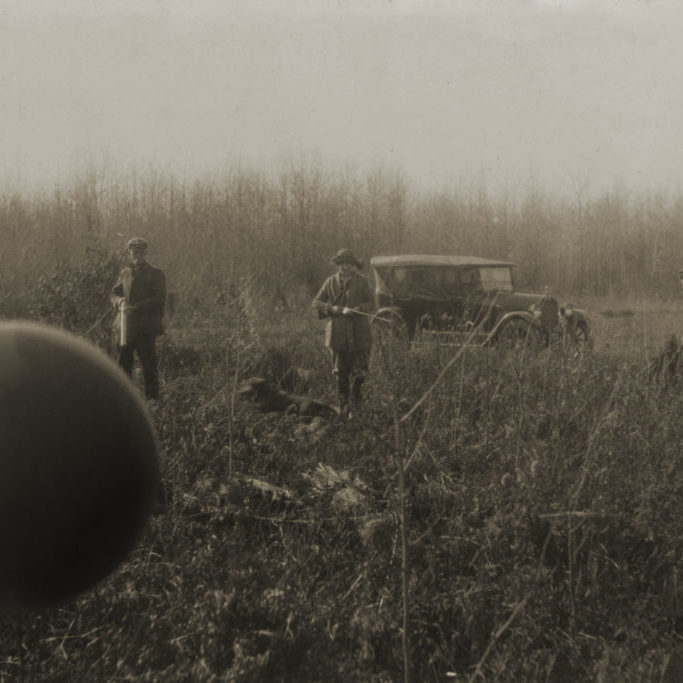 Three individuals holding guns stare at a floating orb.